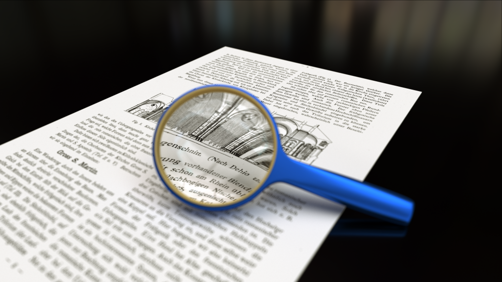Magnifying_glass_with_focus_on_paper